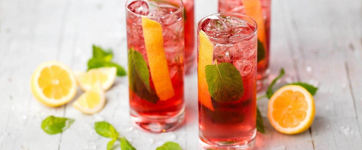 pink port tonic easy wine cocktails with lemon and mint on table